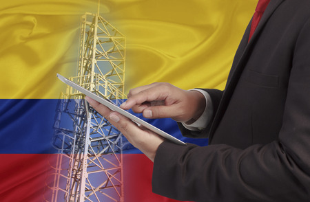 hands free device: business and mobility communications concept Colombia Flag background