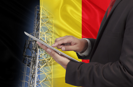 hands free phone: business and mobility communications concept Belgium Flag background