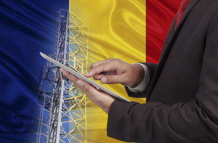 hands free device: business and mobility communications concept Romania Flag background