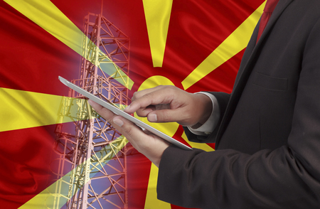 hands free device: business and mobility communications concept Republic of Macedonia Flag background