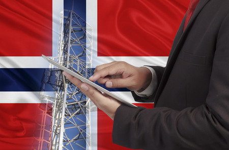 hands free device: business and mobility communications concept Norway Flag background
