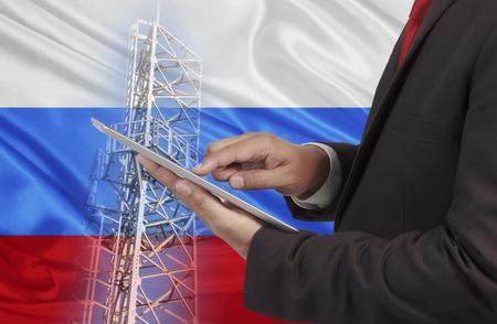 通信: ビジネスやモバイル通信概念ロシア国旗背景