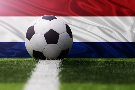 netherlands flag: soccer ball against Netherlands flag