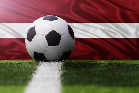 latvia flag: soccer ball against Latvia flag