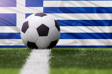 Greece soccer ball against Greece flag Stock Photo