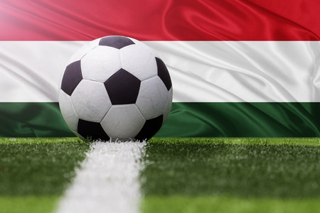 hungary: Hungary soccer ball against Hungary flag Stock Photo