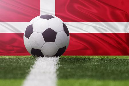 Denmark soccer ball against Denmark flag