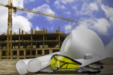 file of safety helmet on wood table,building construction