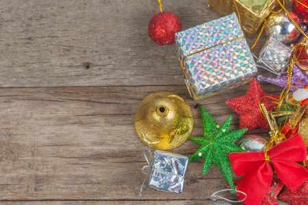 Chrismas baubles and vary of decoration on wood background Standard-Bild