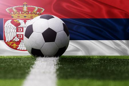 serbia flag: soccer ball against Serbia flag Stock Photo