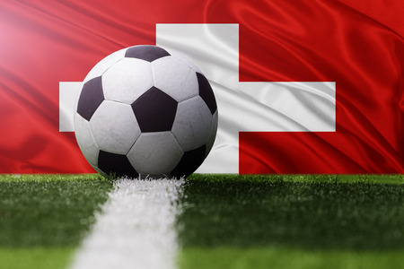 soccer ball against Switzerland flag Stock Photo