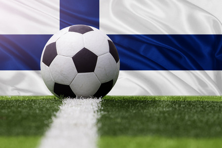 finland: Finland soccer ball against Finland flag Stock Photo