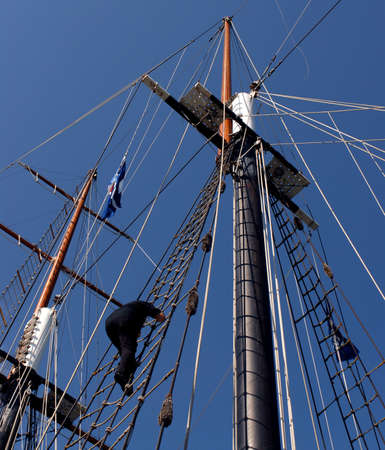 A crewmember climbing the rigging of The Empire Sandy at Canal Days in Port Colborne, Ontario. August 52006