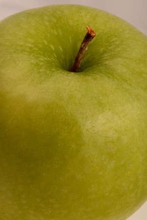 Macro photo of green apple.