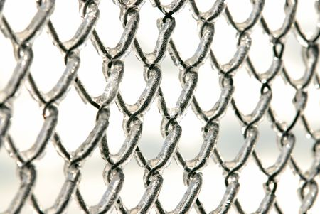 Photo of a chain link fence after an ice storm. photo