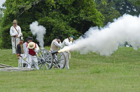 FORT ERIE, ONTARIO, CANADA - August 62011- An American gun crew fires during an artillery demonstration in Fort Erie at the annual Siege of Fort Erie weekend reenactment, a reenactment of one of the battles of the War of 1812.