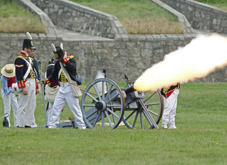 erie: FORT ERIE, ONTARIO, CANADA - August 62011- An American gun crew fires during an artillery demonstration in Fort Erie at the annual Siege of Fort Erie weekend reenactment, a reenactment of one of the battles of the War of 1812.