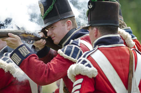 FORT ERIE, ONTARIO, CANADA - August 62011- A British soldier fires his weapon at the American Infantry at the annual Siege of Fort Erie weekend , a reenactment of one of the major battles of the War of 1812.