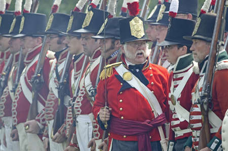 erie: FORT ERIE, ONTARIO, CANADA - August 62011- A British officer command his men in formation during the battle reenactment at the annual Siege of Fort Erie weekend , a reenactment of one of the major battles of the War of 1812. Editorial