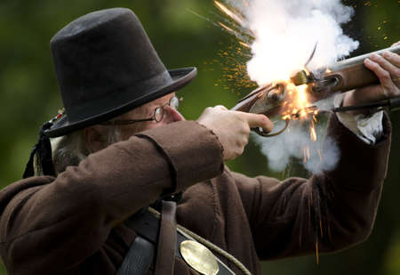 A War of 1812 reenactor fires his musket at a display at Jordan Museum Editorial