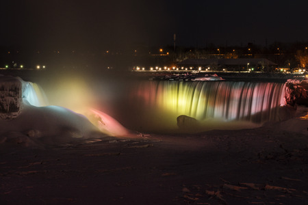 The Horseshoe Falls lit up at night in Niagara Falls, Ontario, Canada.