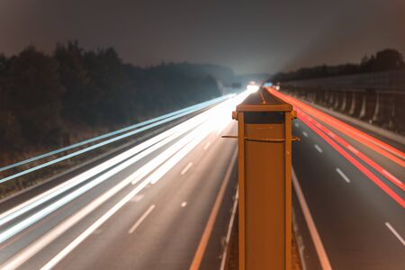 A4 Highway in Germany Chemnitz. Long time exposure of traffic on the move with close up of metal that seperates left and right with copy space 版權商用圖片