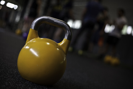 yellow crossfit kettlebell in a gym