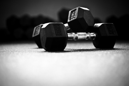 Weight-lifting in a crossfit gym Dumbells II 스톡 콘텐츠