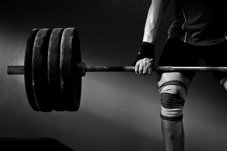 Man practicing weightlifting II