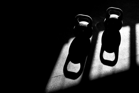 kettlebells and shadow in a CrossFit gym