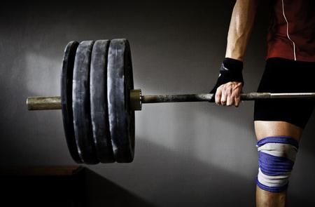 Man practicing weightlifting I Foto de archivo