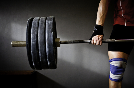 Man practicing weightlifting I Stock Photo