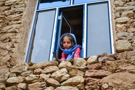 Cute Kurdish girl with blue head scarf posing in Palangan village Editöryel