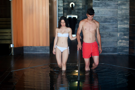 mujer: young couple relaxing spa water entering