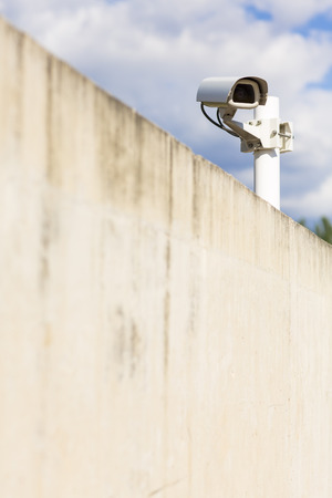 cctv camera: CCTV camera. Security camera on the wall. Private property protection.