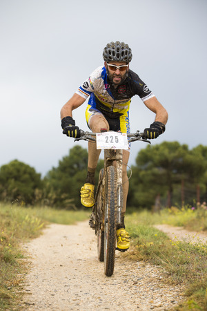 GRANADA, SPAIN - JUNE 1: Unknown racer on the competition of the mountain bike La Mamut Padul Bike on June 1, 2014 in Granada, Spain