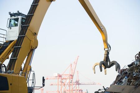 grabber: Crane grabber loading metal rusty scrap in the dock Stock Photo