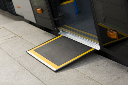 on ramp: Access ramp for disabled persons and babies in a bus Stock Photo