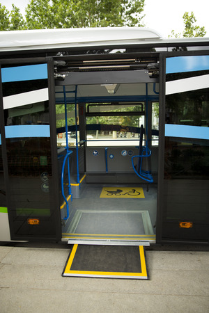 ramp: Access ramp for disabled persons and babies in a bus Stock Photo