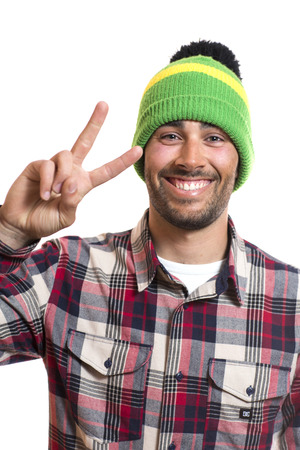 young man: Smiling handsome young man with wool cap