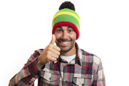 handsome young man: Smiling handsome young man with wool cap saying OK
