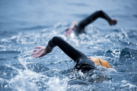 Group of unknown Swimmers at sea. Standard-Bild