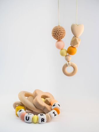 Orange handmade silicone breastfeeding necklace and teething ring