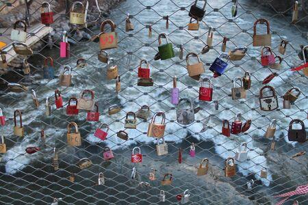 love locks (padlocks) on a bridge in Graz (Austria)