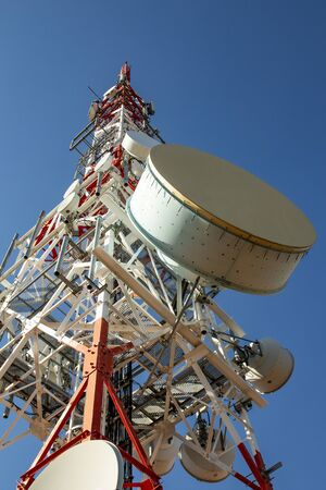 Telecommunications antenna for radio, television and telephony whit cloud and Blue sky