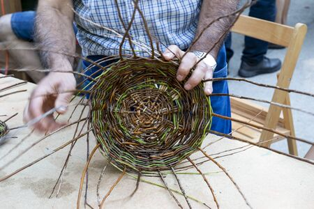 The craftsman's hands making a wicker basket. Leon, Spain Stock fotó