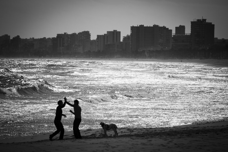 Two friends playing Capoira in San Juan Beach, Alicante photo
