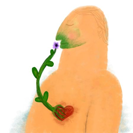 Man smells flower that grows with roots from its heart photo