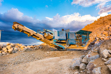 Stone crusher in a stone extraction mine. Heavy machinery to process stone 写真素材