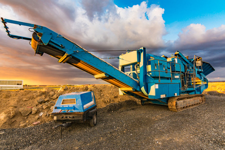 Stone crusher in a stone extraction mine. Heavy machinery to process stone Stock Photo